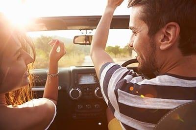 Happy Couple In Car | UK Car Finance