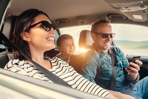 Happy Family In car | UK Car Finance