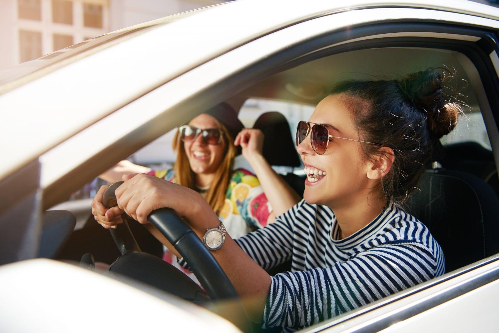 Girls in Car Laughing